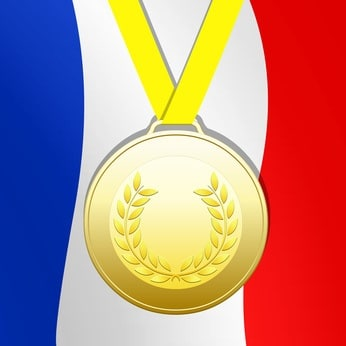 Mdaille dor sur fond drapeau franais
